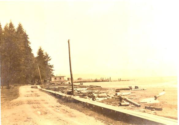 What is today residential waterfront property was once a popular picnic spot and campground between Colby and Curley Creek. This photo, probably taken around 1930, looks North toward the lumber mill, with the road now called Yukon Harbor Drive in the foreground. Photo provided by Shirlee Toman.