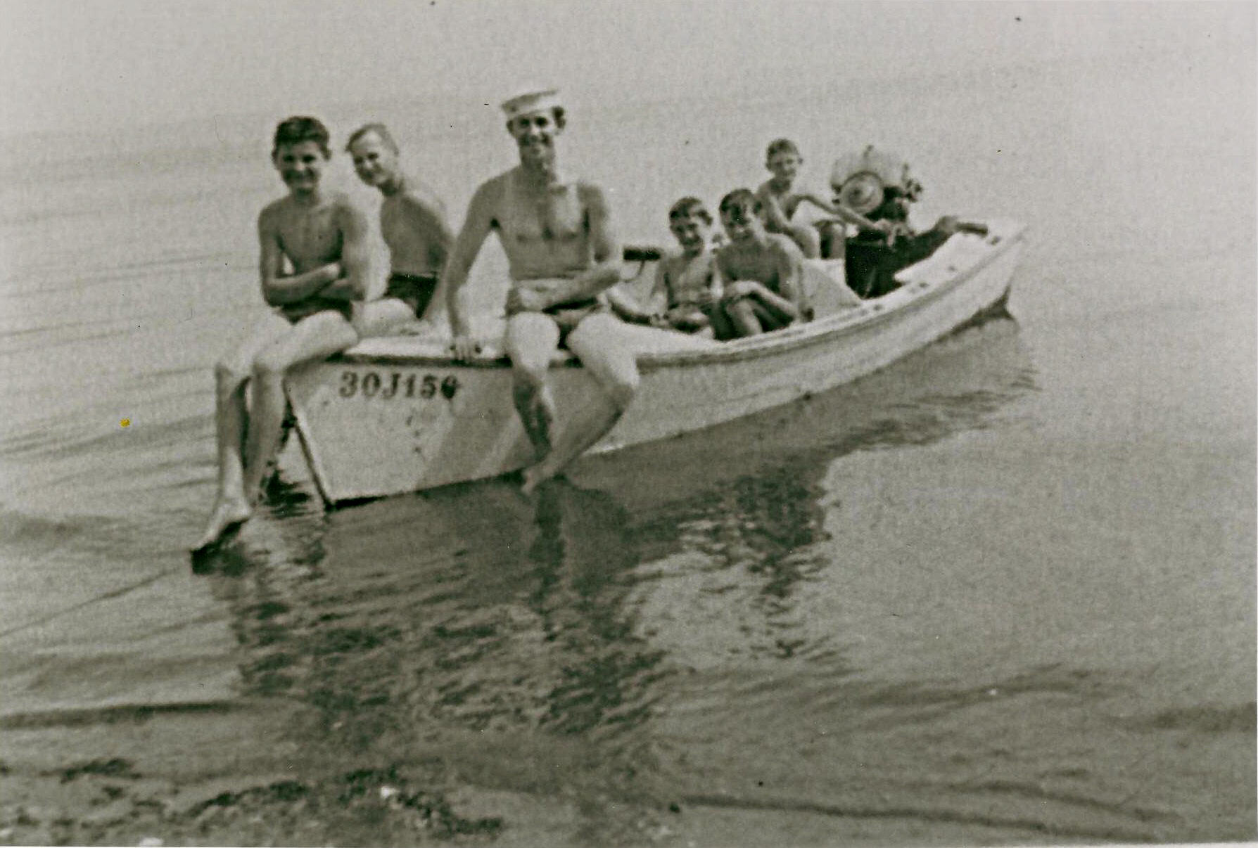 boatload of Holmes, loaded into a small boat along the Blake Island