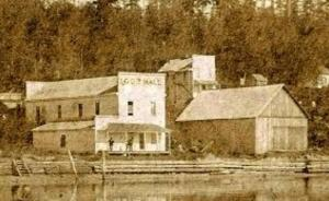 The Independent Order of Good Templars Hall (left) c1888. It had a meeting room upstairs and a store below, with an adjacent warehouse (right). It was built by Civil War Vet John Anspaugh, as was the white two-story residence/boarding house (background).