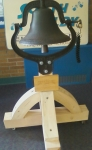 Restored Bell -- The stand created for its new role at South Colby Elementary is unique and unconventional (it was originally intended to simply be bolted to a schoolyard post) but it needed to be portable, short, and sturdy. It has wheels hidden under the four legs, and can be rolled in and out of various facilities.